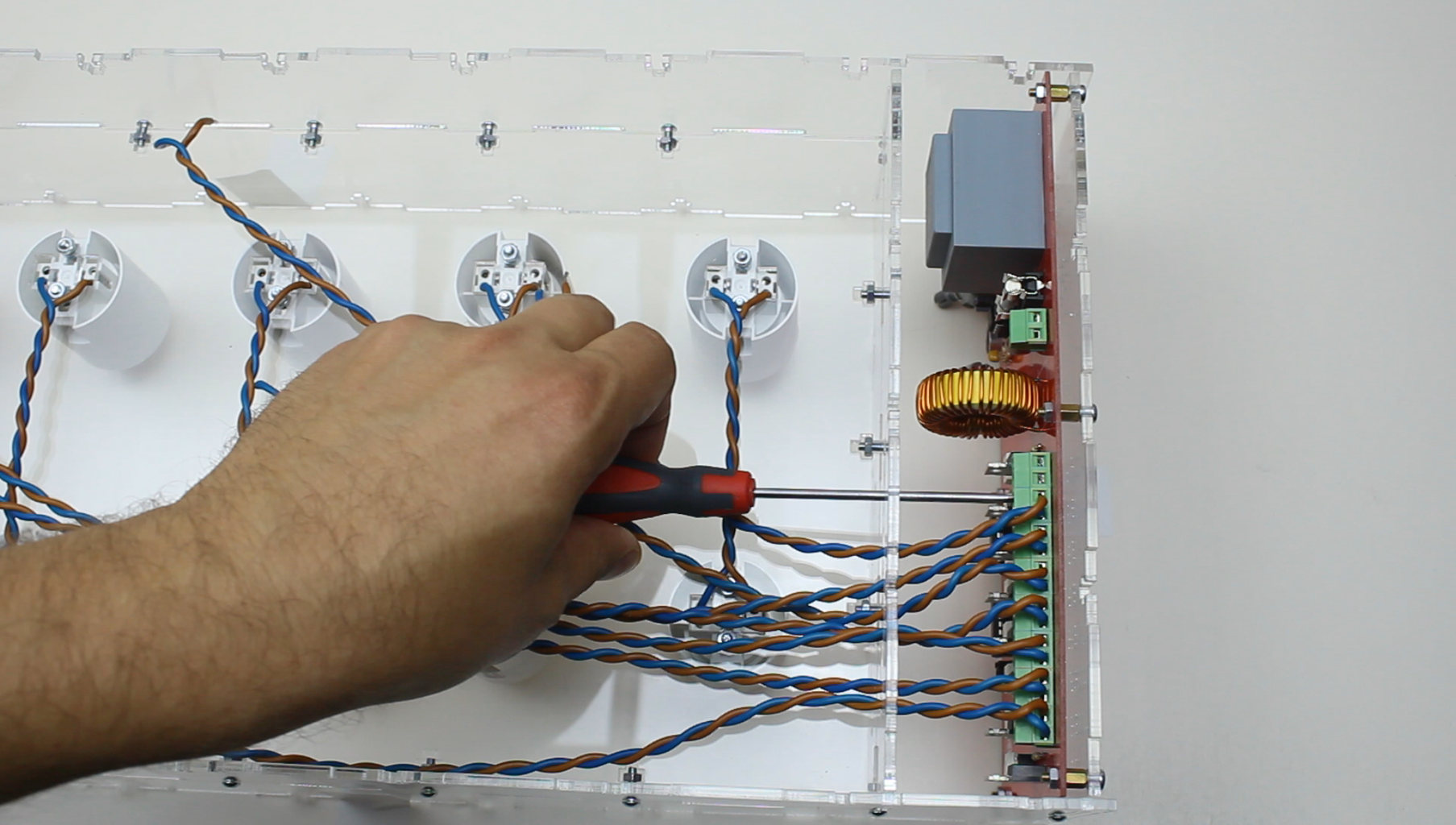Installing Wires From Each Individual Level Into Terminal Holes.