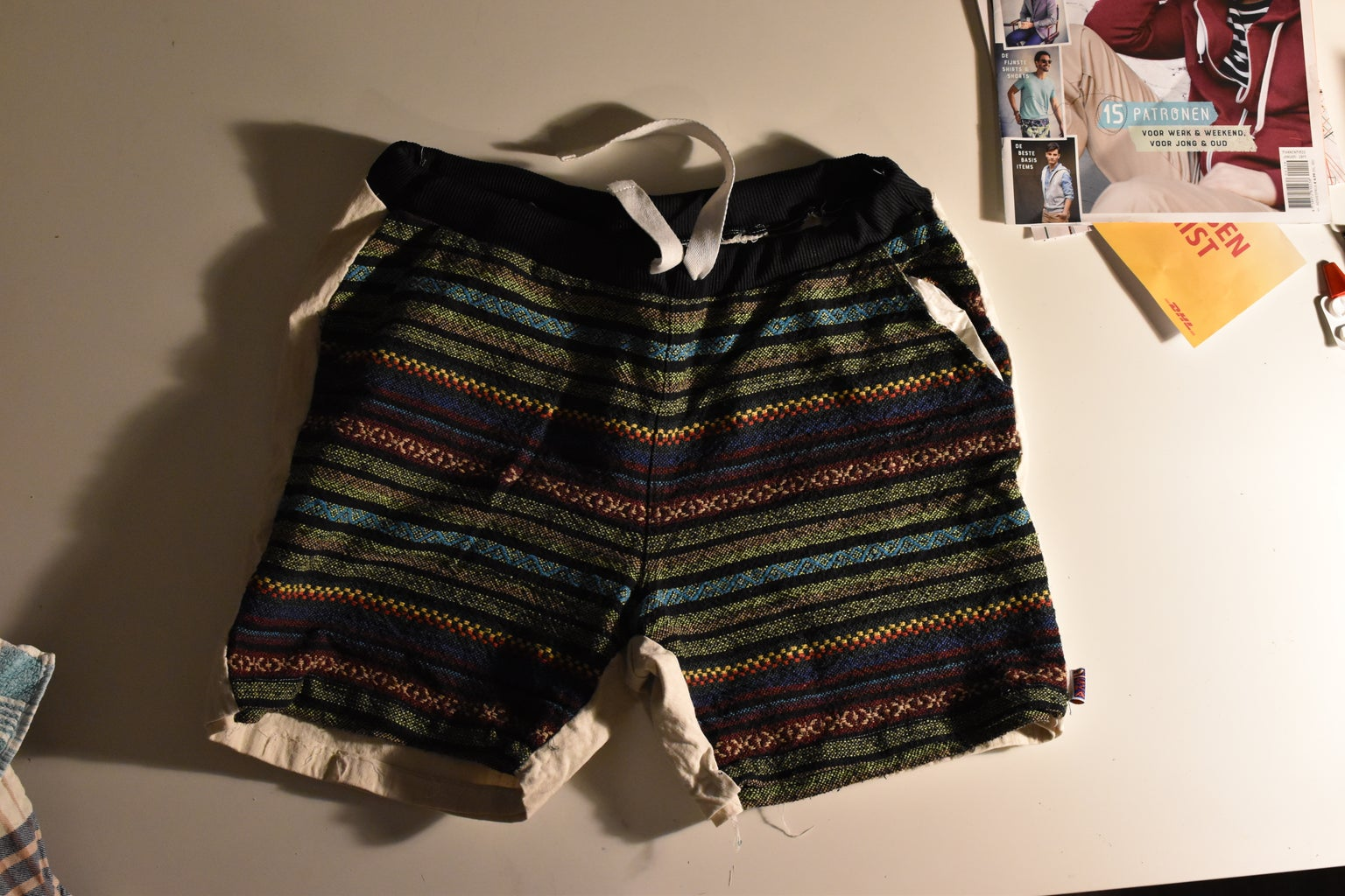 Find an Item of Clothing or Any Textile That Has Some Surfaces Big Enough to Make a Pouch Out Of