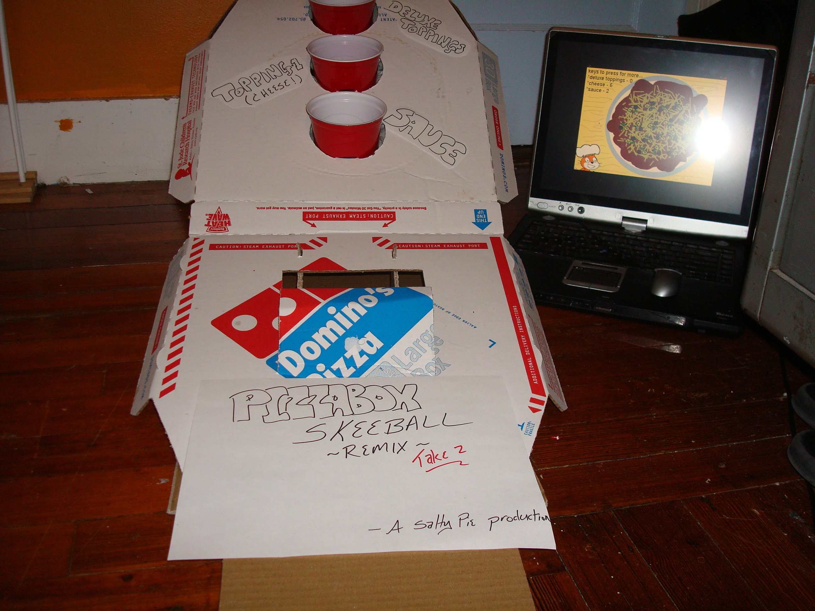 Make Skeeball-inspired Games Using Pizza Boxes, Party Favors, and a PC