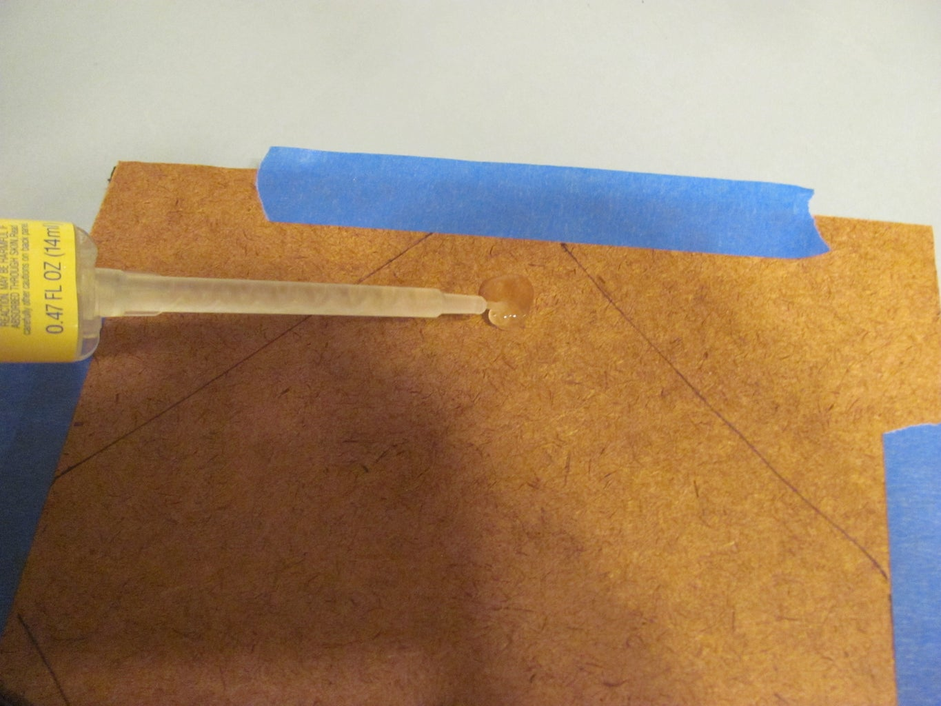 Glue the Spool Assembly to the Hardboard on the Book