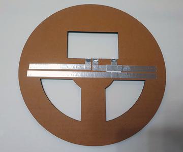 Attach Aluminum Tape to Corrugated Board.