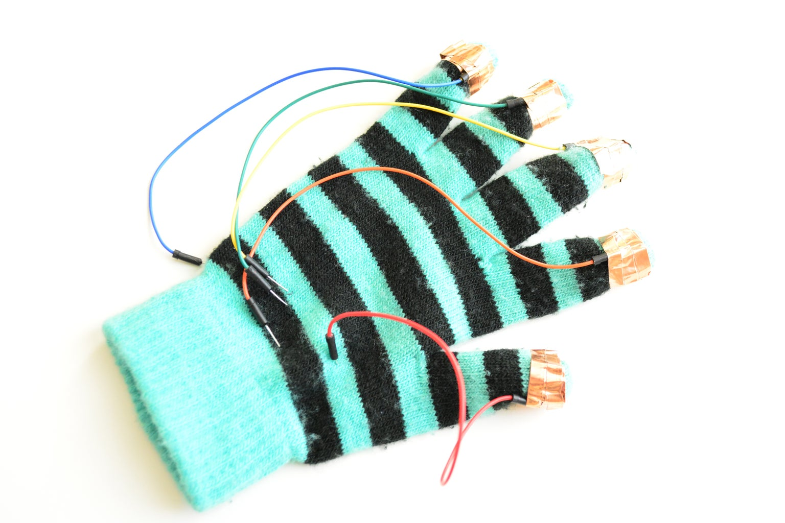 ATTACH JUMPER WIRES TO FINGER TIPS WITH COPPER TAPE