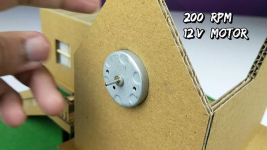 Insert the LED's As Shown. Insert the Motor in the Hole Made for It in the Cardboard.