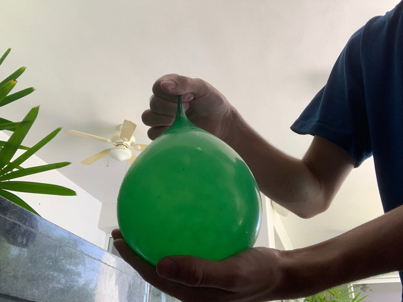 Blow Up a Balloon and Place It in a Cup