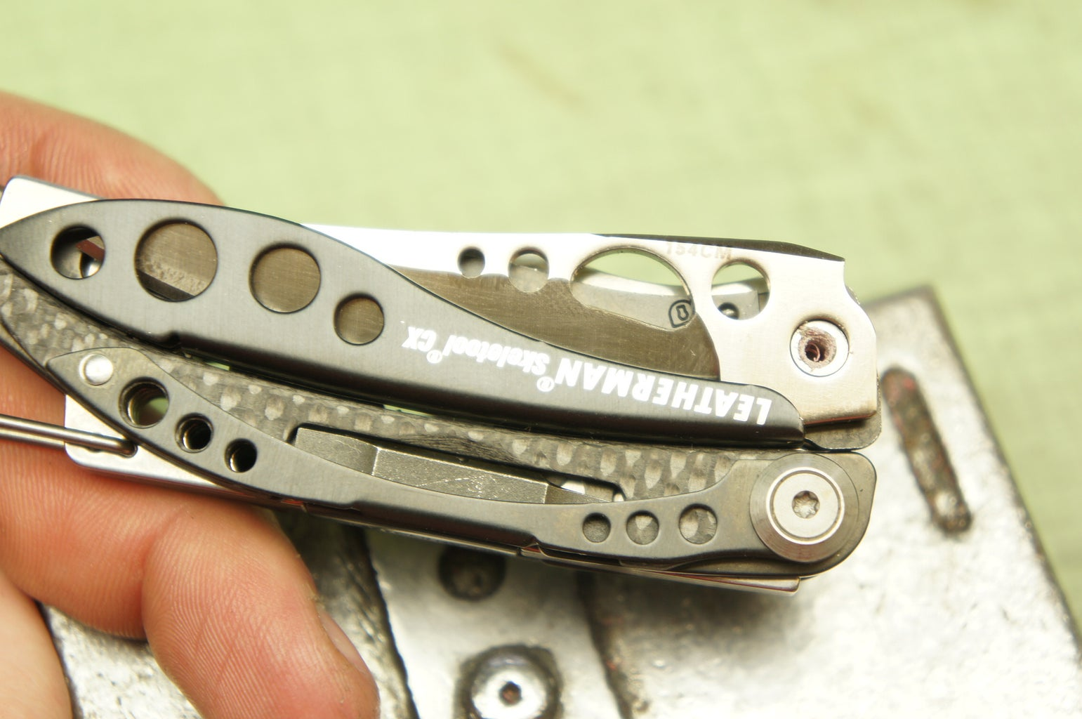 Flip the Tool Over and Remove the Top Screw