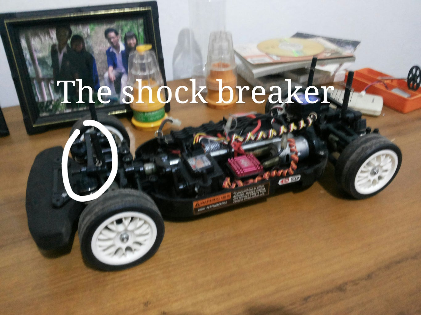 Open Up and Unscrew the Shock Breaker.