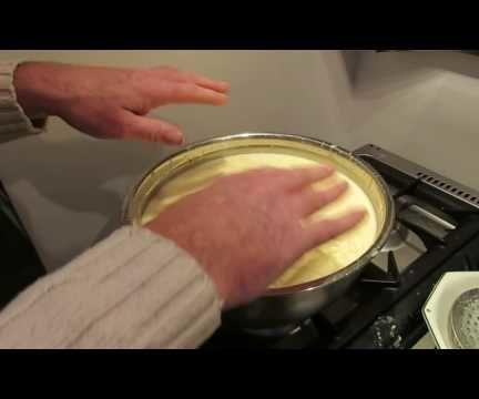 Beef Dripping Lard Rendering animal fat washing with water spray to clarifiy / clean it.