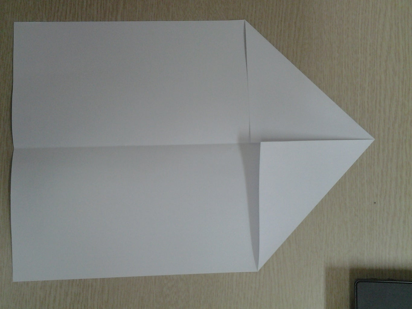 Fold the Paper So the Top Edge of the Paper Touches the Center Line.