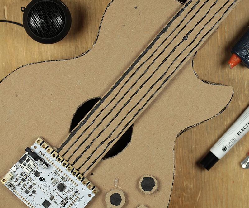 Make a musical cardboard guitar