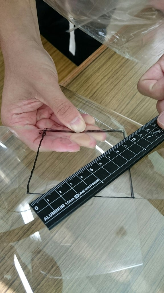 Measuring and Cutting Plastic Board