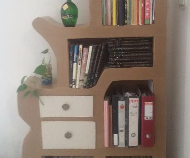 Recycled cardboard bookshelf -  laser cut and handwork