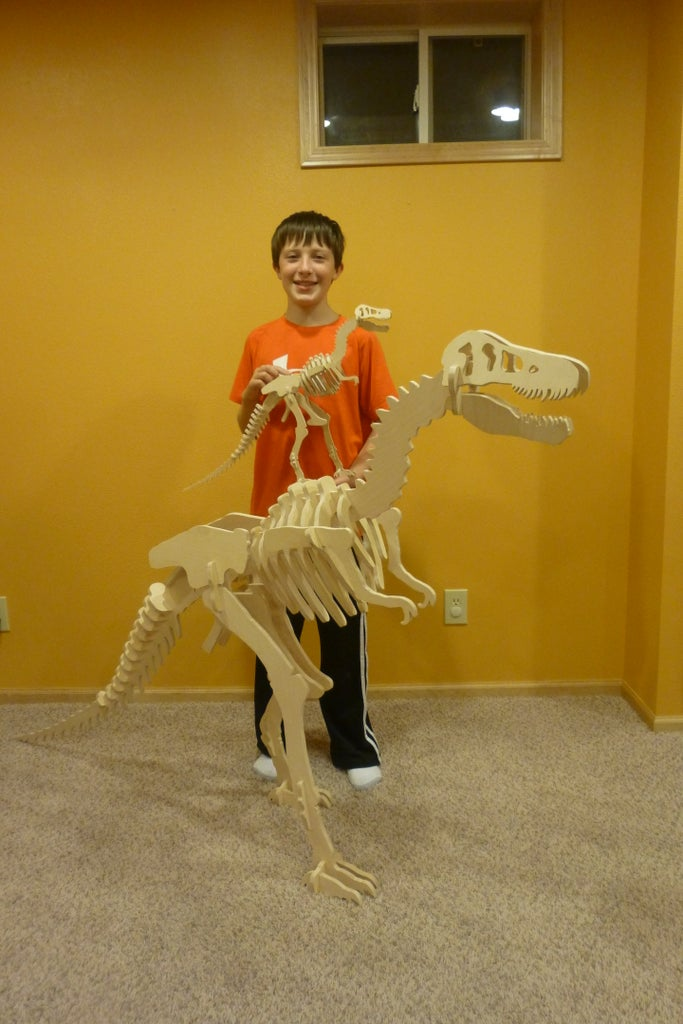 T-Rex Dinosaur Puzzle With Different Sizes and Positions