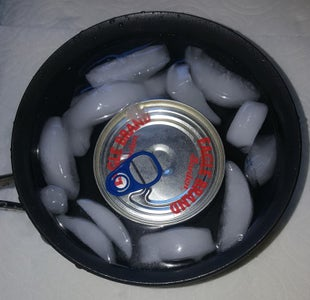 Remove Can and Place in to Cool Water