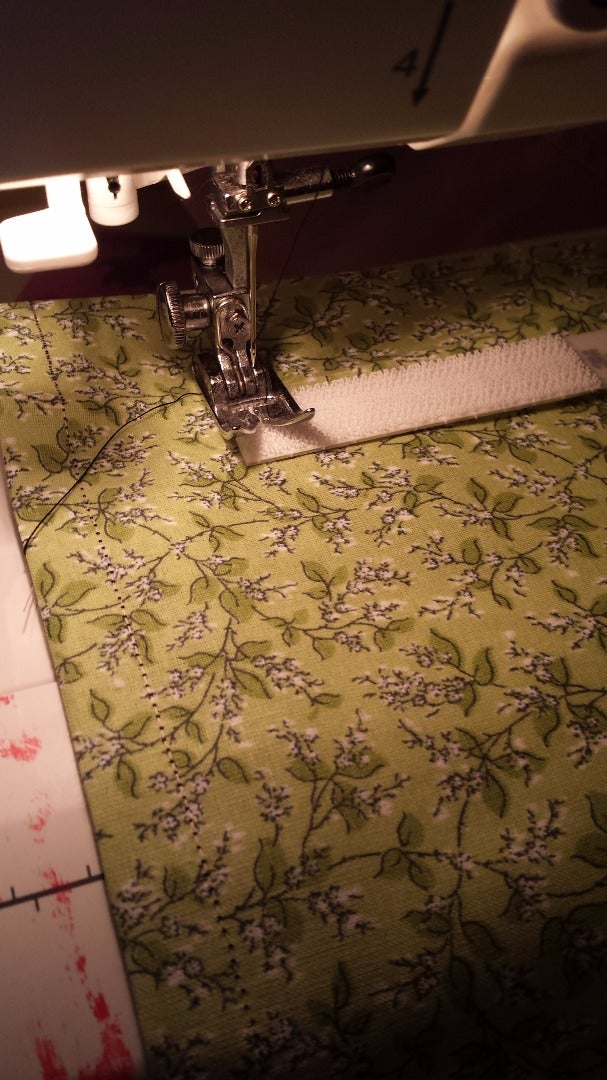 Sew on the Adhesive Fastener.