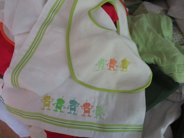 Embroidery for a Bib and Burp Cloth Set.