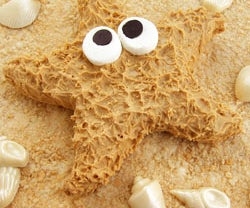 Sandy Cereal Treat Beach Topped With a Peanut Butter Starfish and Shimmering White Chocolate Shells.