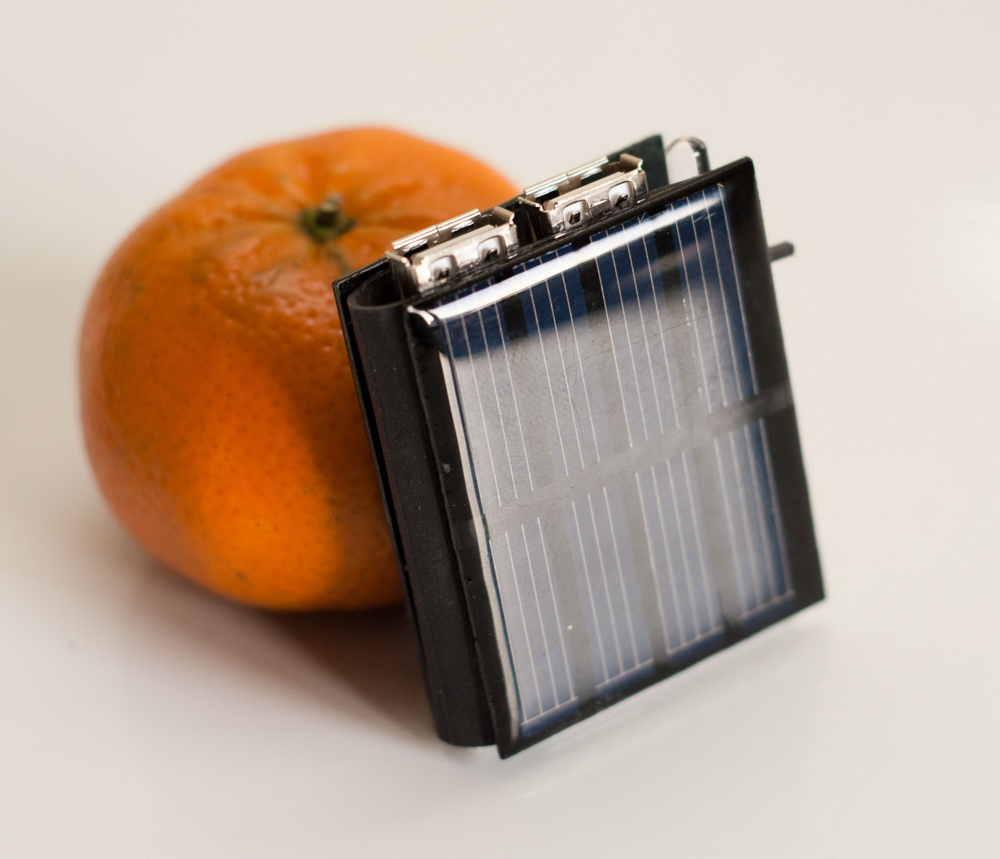"the ""mini solar book"", torch and charger"