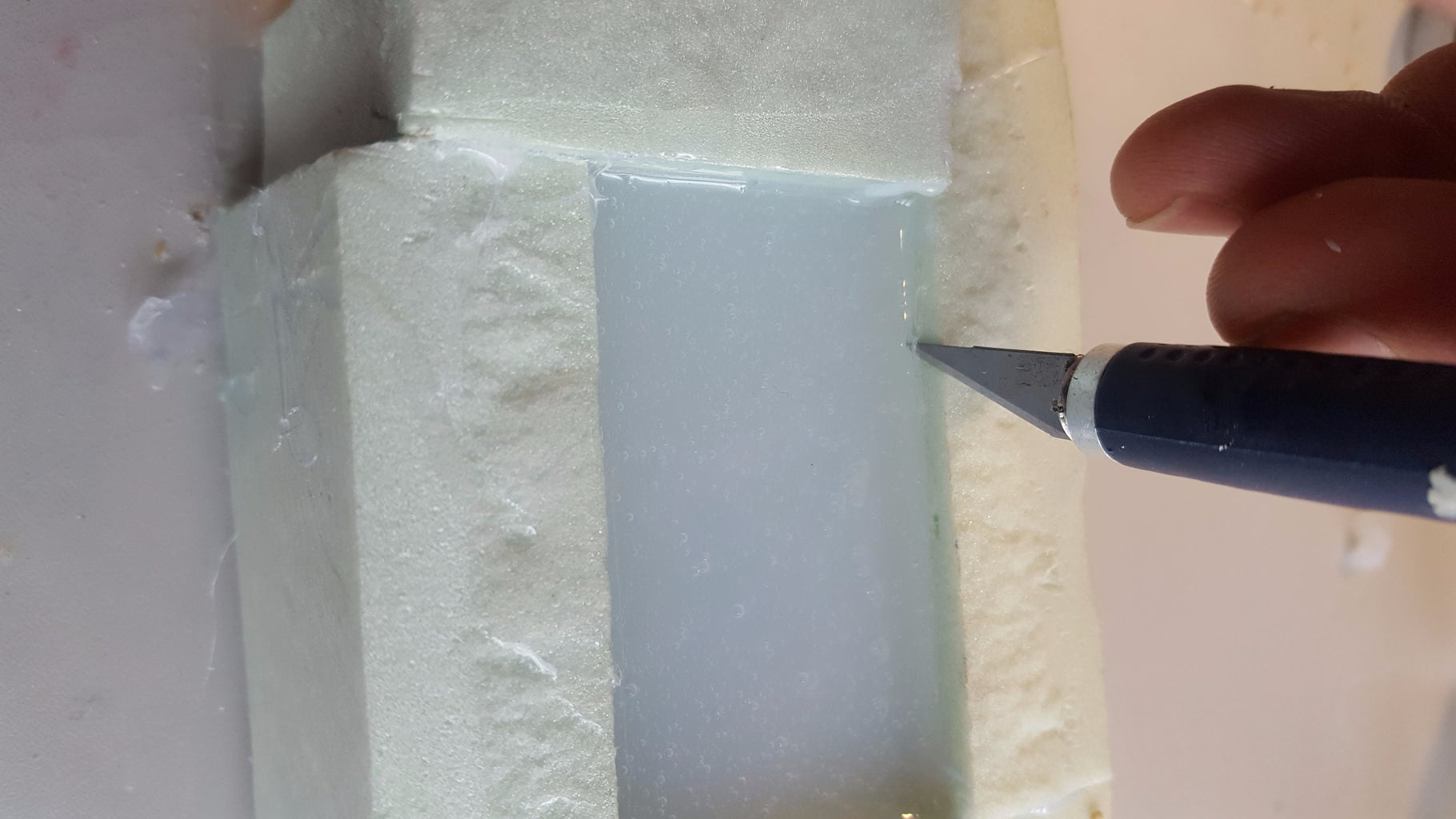 Removing the Figure From the Mold