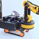 Make OWI Robotic Arm self propelled on tracks controlled wirelessly by the Wii controller and Raspberry Pi