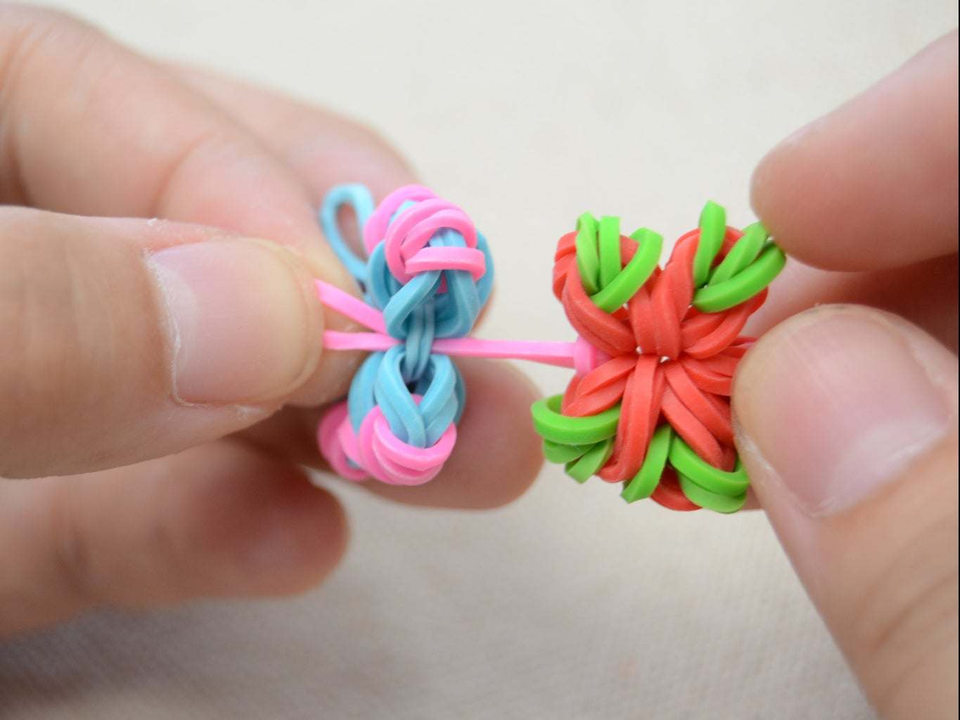 Connect the Second Flower With  the Other End of the Rubber Band;