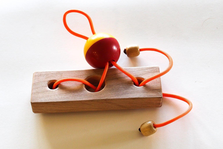 Feed String Through Ball