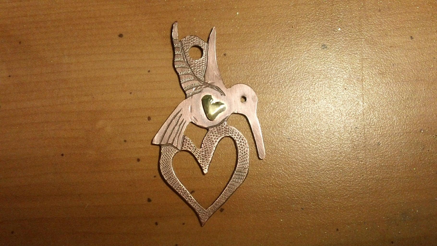 Saw Pierced Hummingbird Memento Pendant