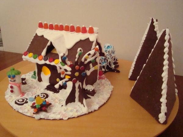 Gingerbread House With Candle-lit Windows
