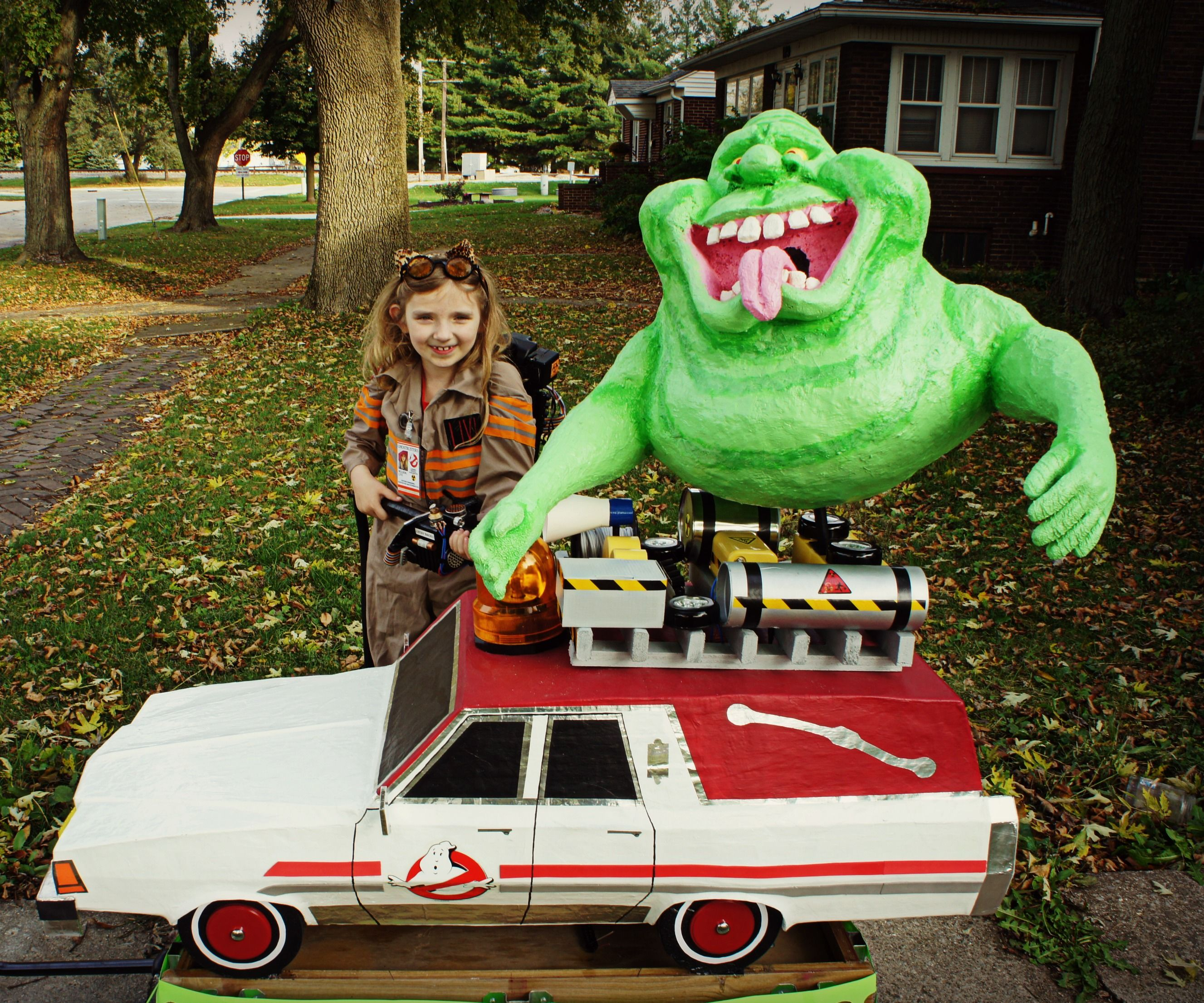 Awesome Ghostbuster with proton pack, Slimer, and Ecto-1