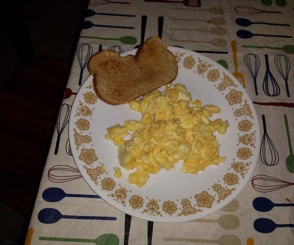 Making Cheesy Scrambled Eggs