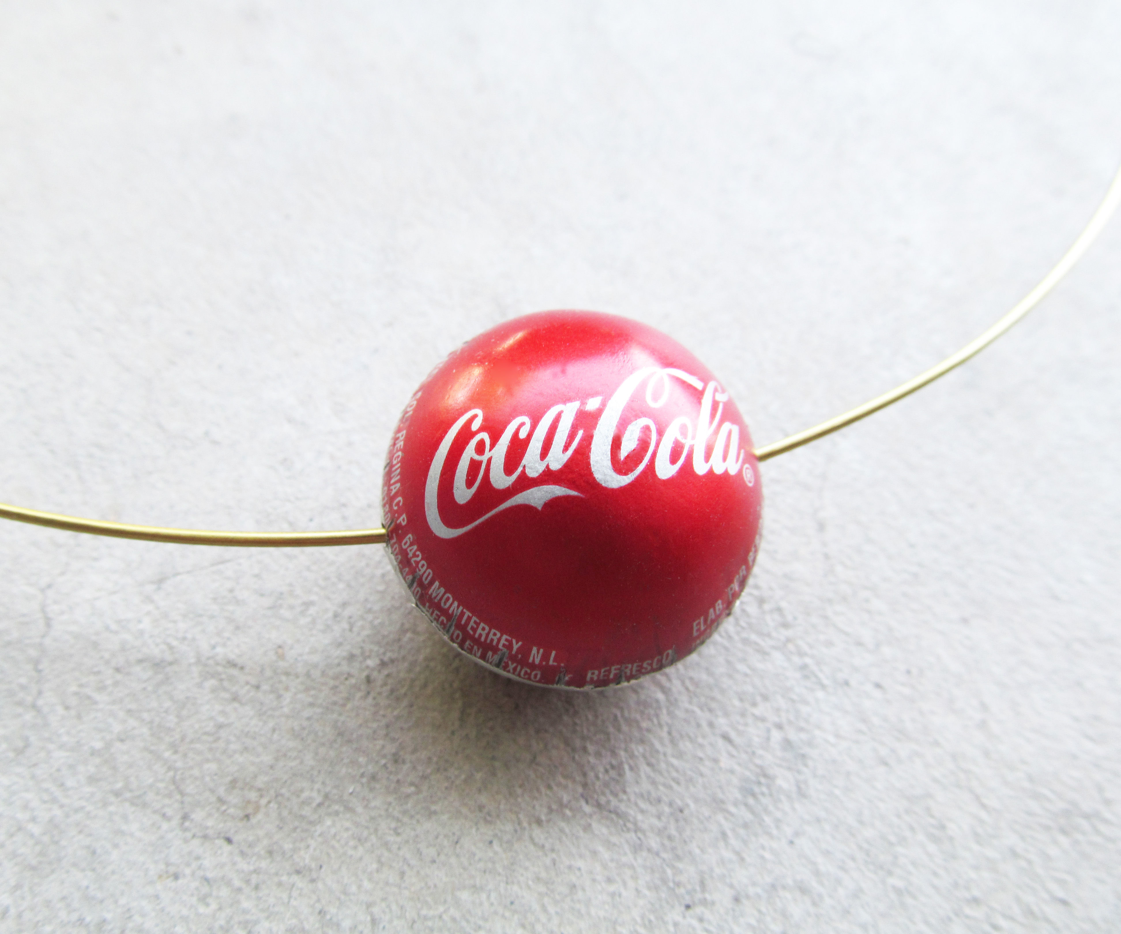 How to make a bottle cap bead.
