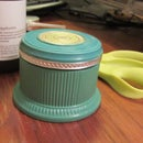 Store your custom facial toner in a vintage jar with reusable cotton pads