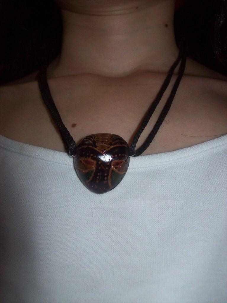 Tiny Tiki Mask Necklace.