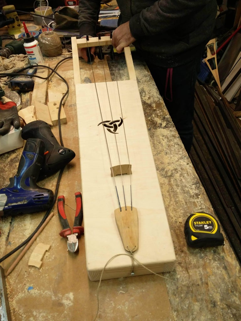 Chamfer the Edges, and Install the Tuning Pegs