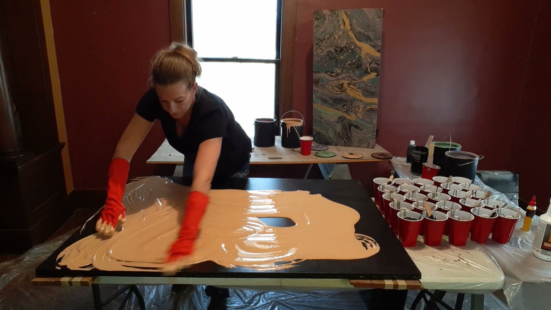 Level the Canvas on the Table.  Cover the Entire Canvas With One Color of Paint.