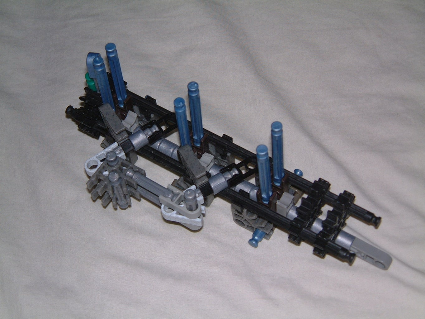 -front End- the Ammunition Hopper, Loading Arms, and Barrel.