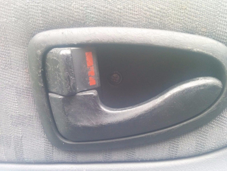 Unhooking the Interior Door Handle