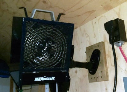 Installing a Heater on a VESA Compatible Articulated LCD Screen Support