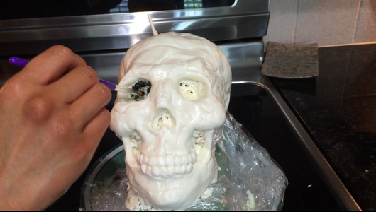 Allow the Skull to Set in the Fridge, Then Paint Details Onto the Skull With Black Icing Color (set the Skull in the Fridge When Done)
