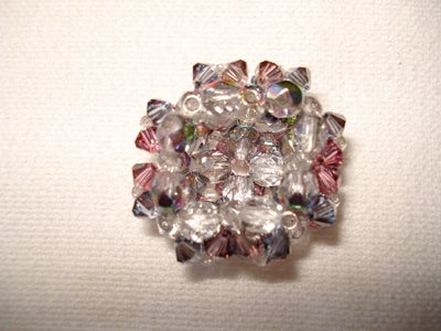 Base of the Pyramid Style 12 Flower Crystal Ring