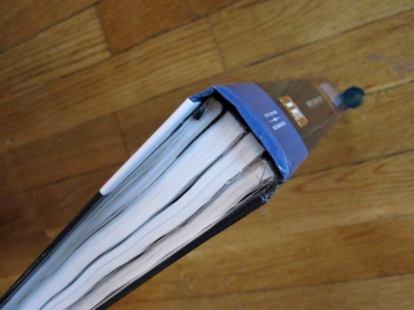 Breaking Heavy Textbooks in to Smaller Books for Easy Carrying.