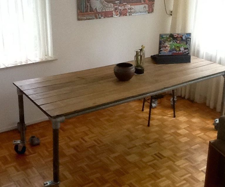 Garden tabletop to big diner table with scaffolding frame.