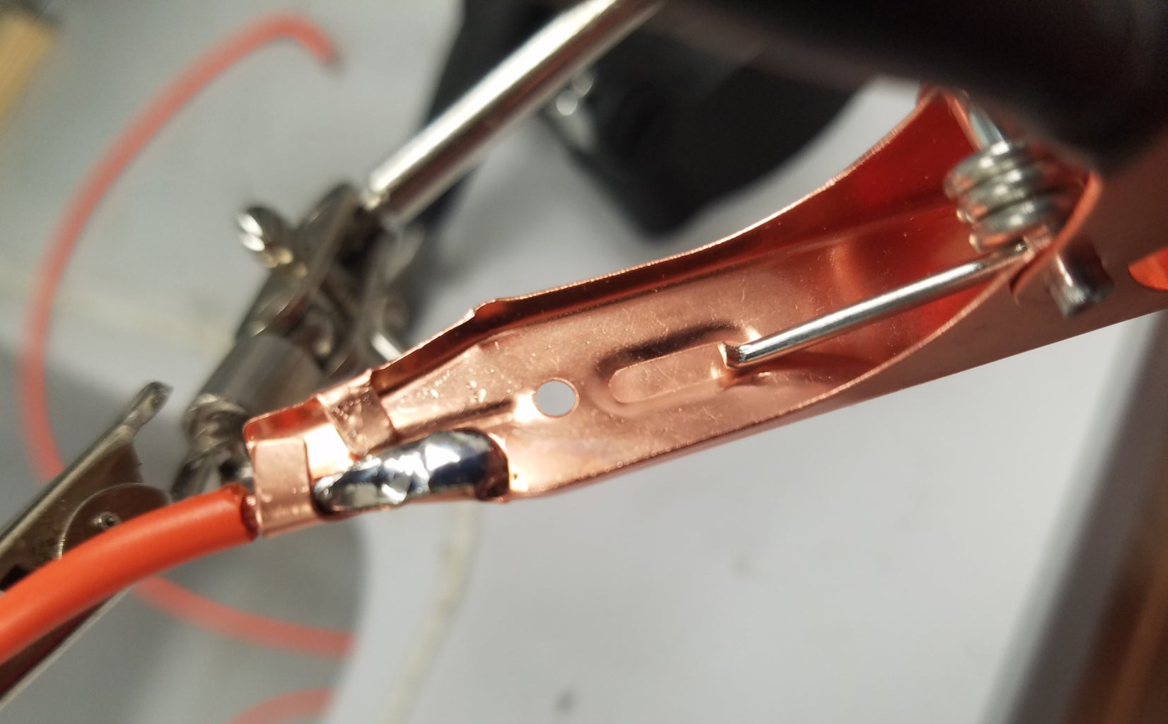 Solder Test Lead Clips Onto the Panel's Terminals