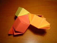 Join the Two Modules of the Orange Edge Back Together. One Vertex of the Polyhedron Is Now Complete.