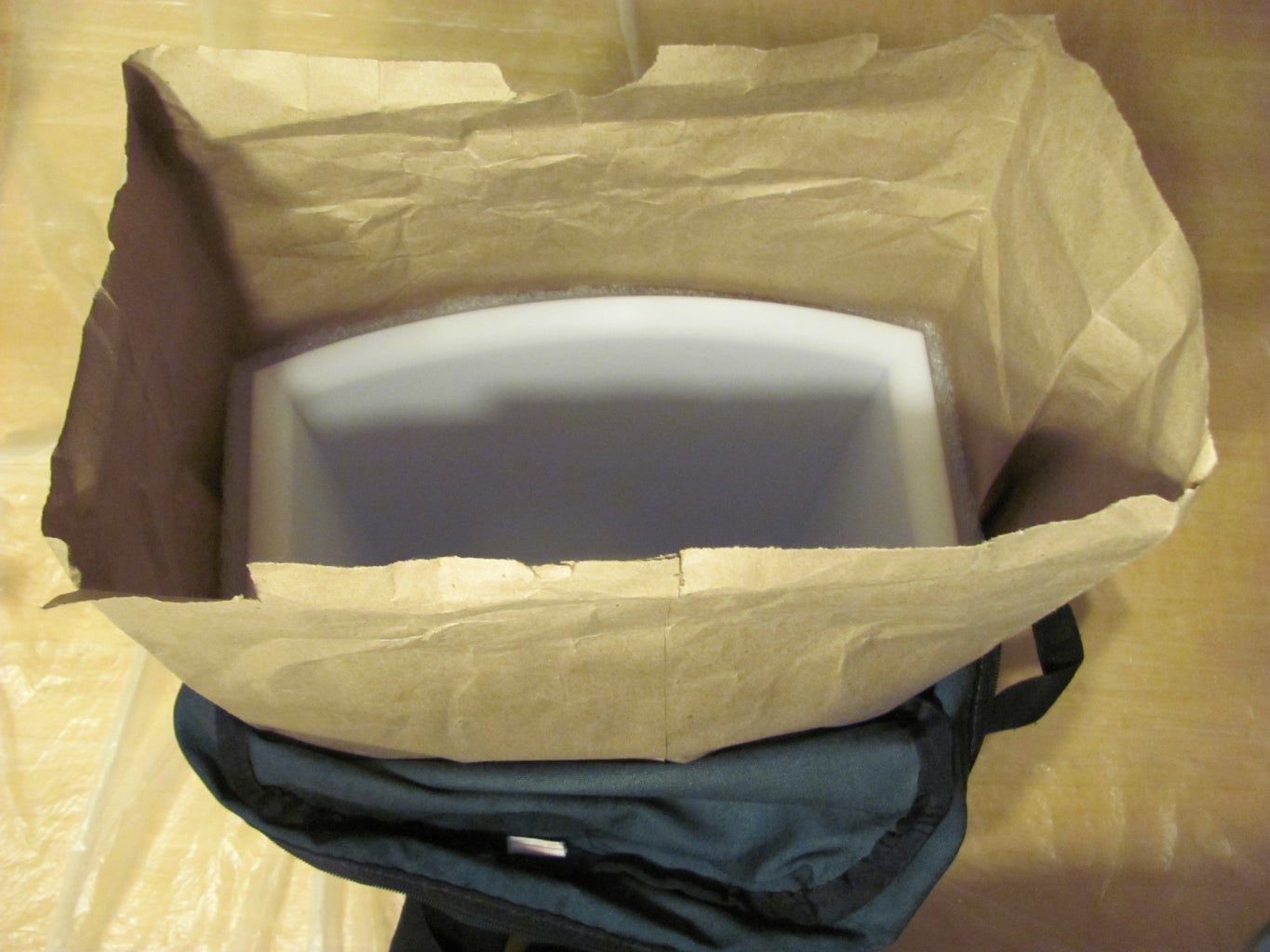 Test Fit Your Trash Can Into the Brown and Plastic Bags and Backpack