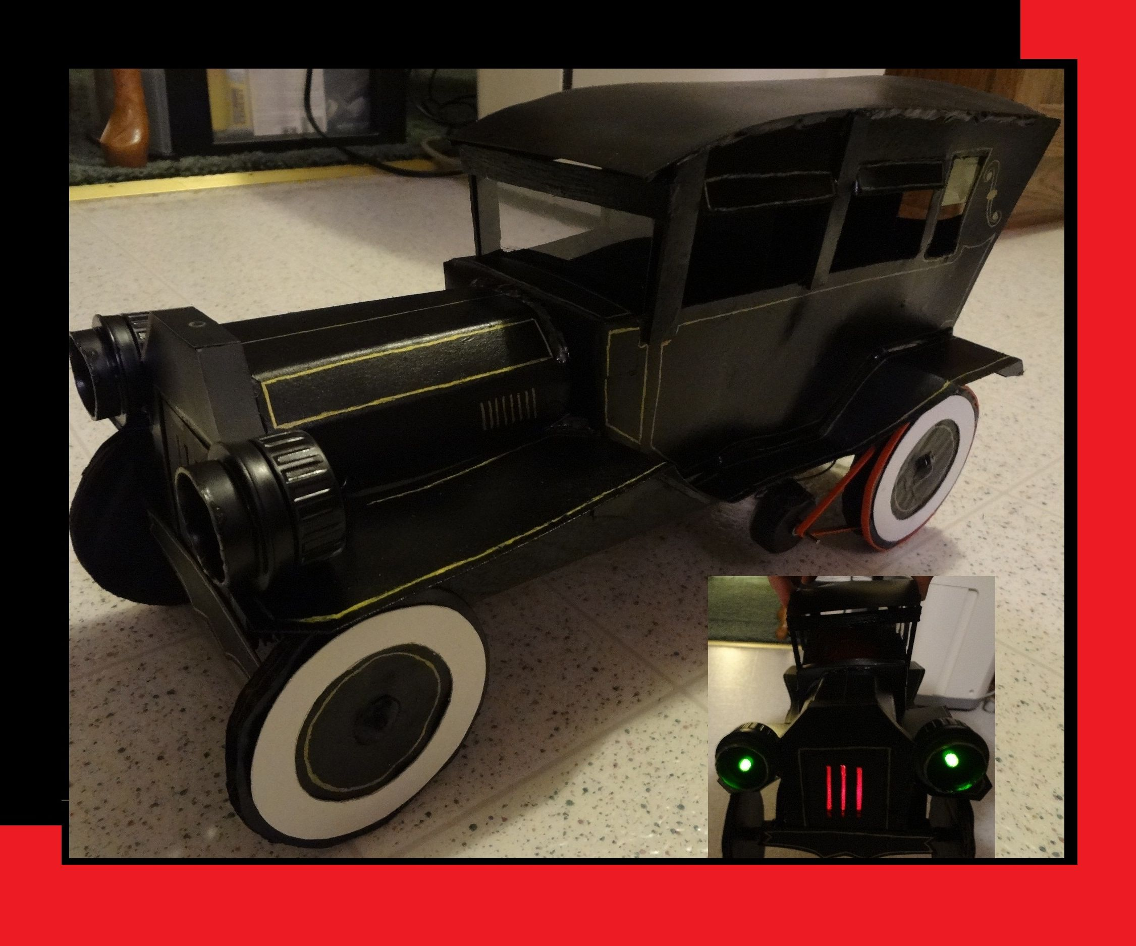 Cardboard hearse car with motor & led's, pulley driven.