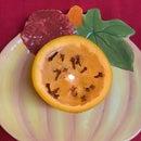 Clove-Scented Orange Candle