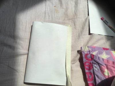 Tape or Glue the Paper Onto the Book