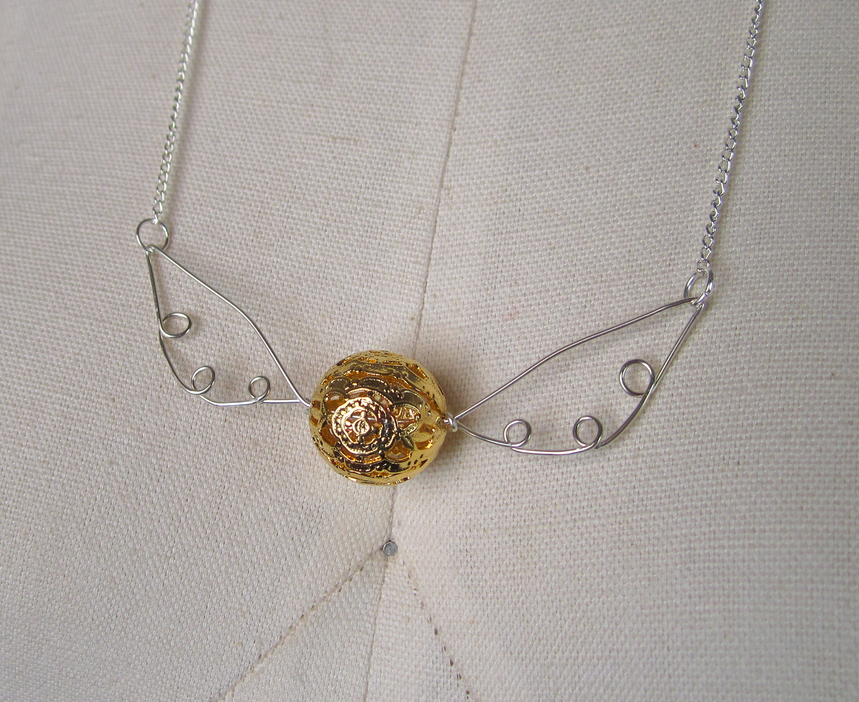 Make a golden snitch necklace!