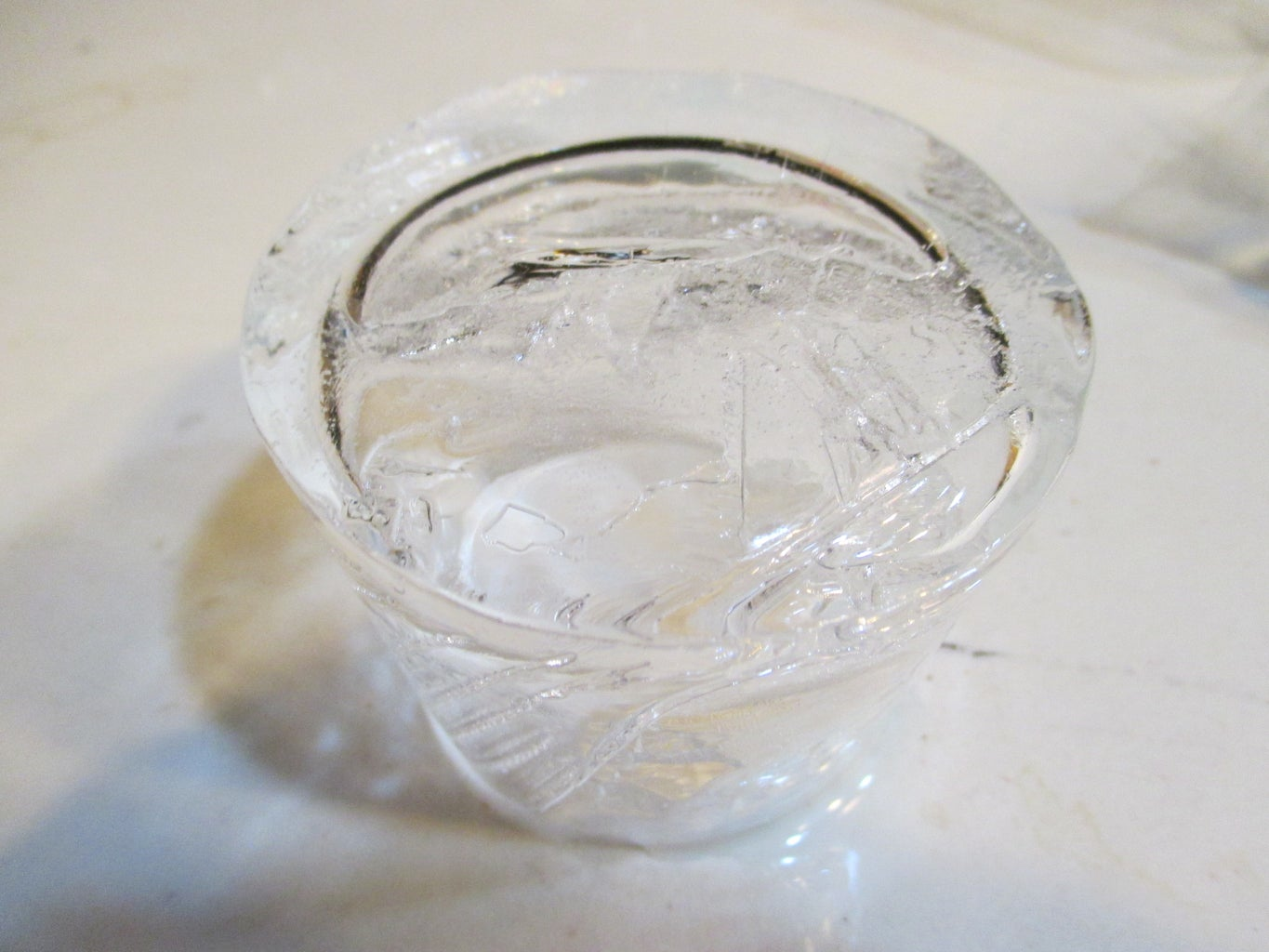 Letting the Yogurt Cup Filled With Water Freeze Partially.