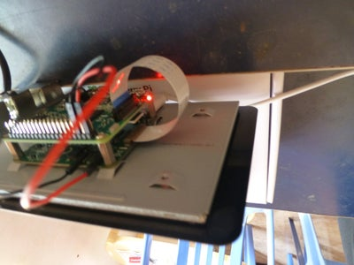 Insert Micro SD Card With NOOBS and Plug in Power Supply